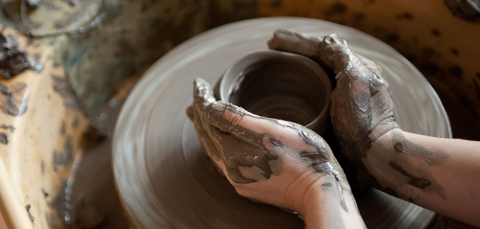 Image of someone doing pottery